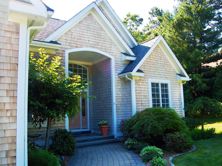 After a low-pressure soft washing treatment for home in Coventry, RI
