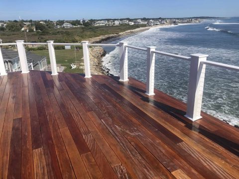 Power Washed Wooden Deck with View of the Ocean in the Background