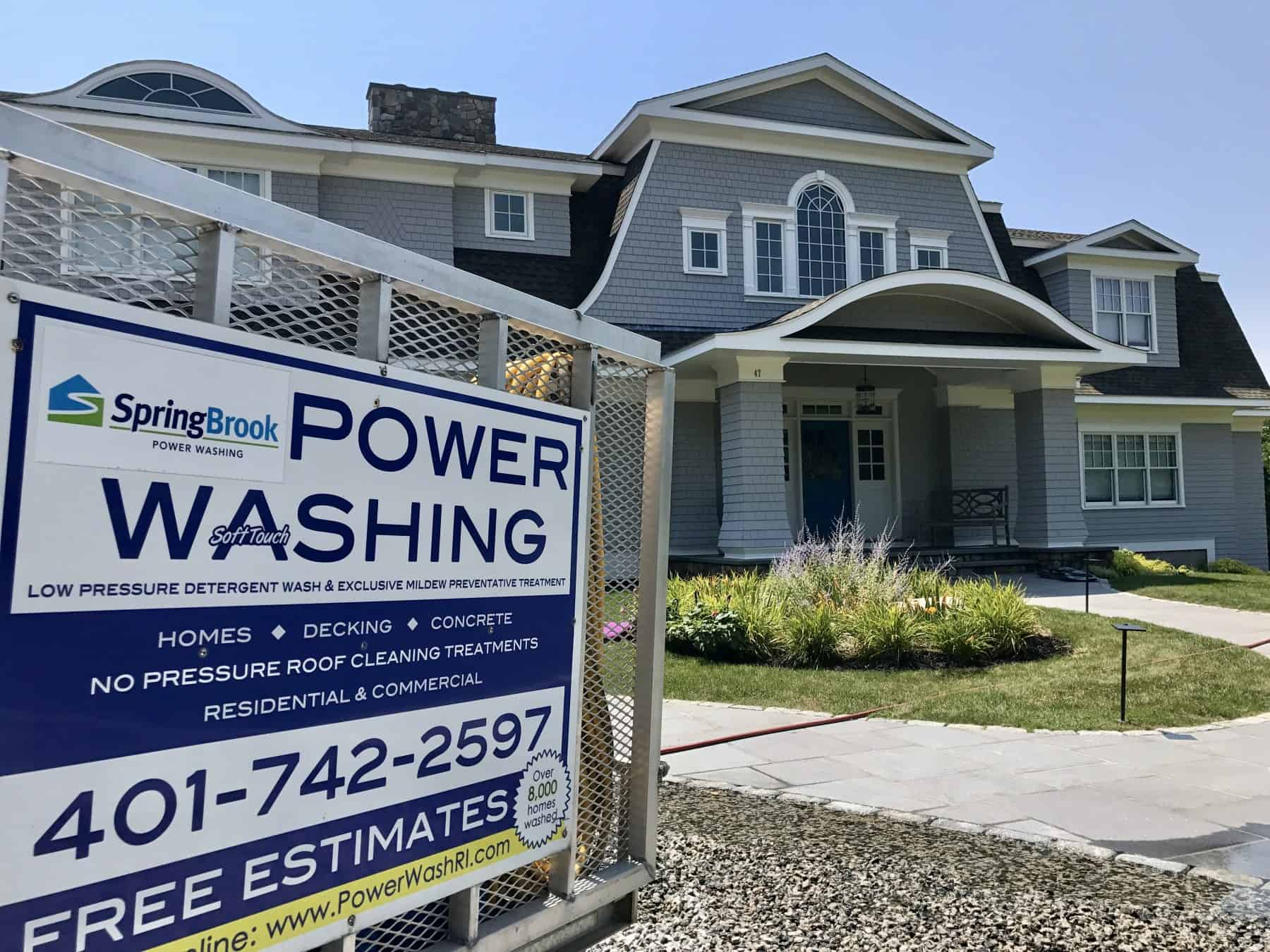 SpringBrook Power Washing Sign in Front of a House in Rhode Island
