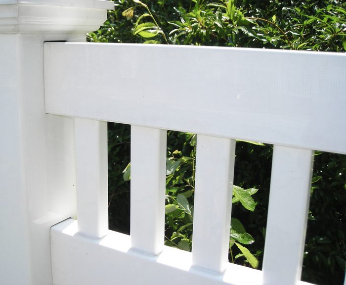 White Vinyl Fence After Power Washing
